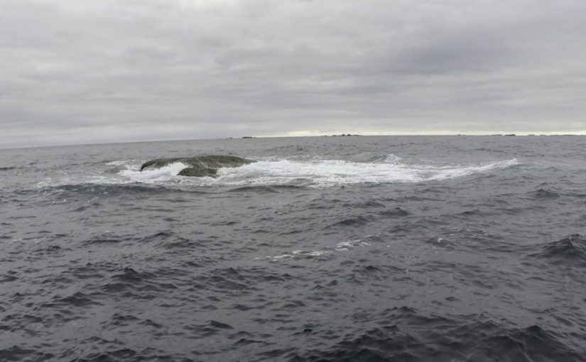 The Gilstone as seen from the surface. Note the Bishop Rock lighthouse on the horizon.