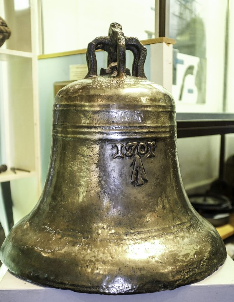 Shiny bronze bell with the date 1701 on its surface
