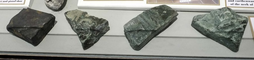 Fragments of bronze bell in a display case