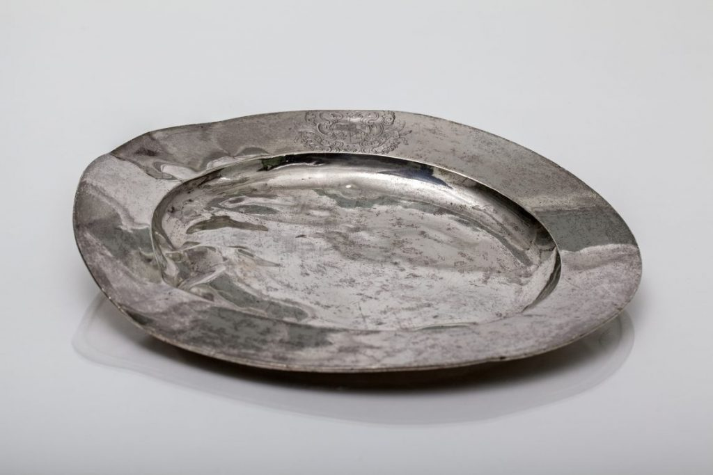 Silver plate – slightly buckled and shiny
